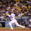 Puig out Tuesday with hamstring/knee flare-up, is available off bench