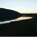 A view of the Chemung river at sunset from the levy path