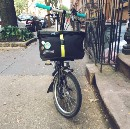 A tiny review of a medium-sized bag for a small folding bike: the Brompton Roll Top Shoulder Bag
