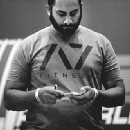 Your Powerlifting Coach Should Be More Than Just A Programmer