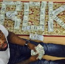 50 Cent resorts to showing off fake money on Instagram