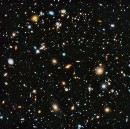Could dark energy be caused by a reaction to what's in the Universe?
