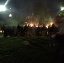 Torch-wielding mob stages rally to protest the removal of racist imagery