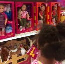 Why are all the white dolls sitting together on the Target shelf?