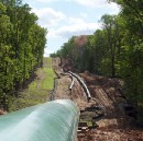 When Small is Strategic: tactical delays in shale gas pipeline expansion