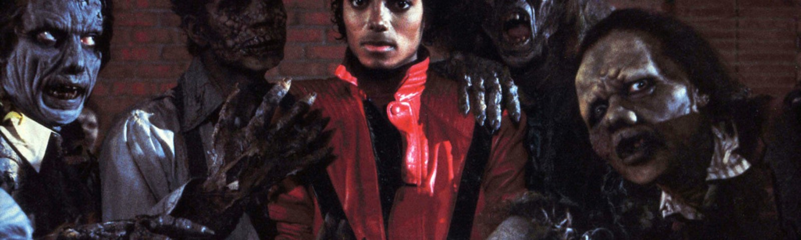 """Michael Jackson pictured flocked by monsters, in the classic video """"Thriller."""""""