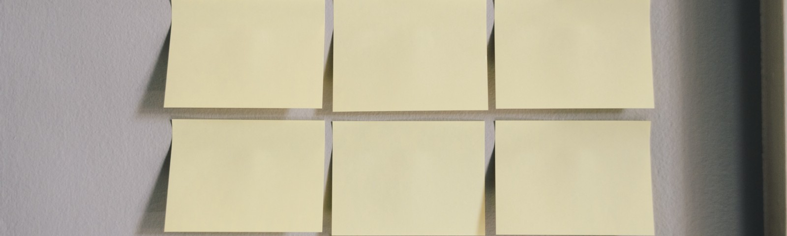 A woman placing nine blank sticky notes like our subconscious mind.