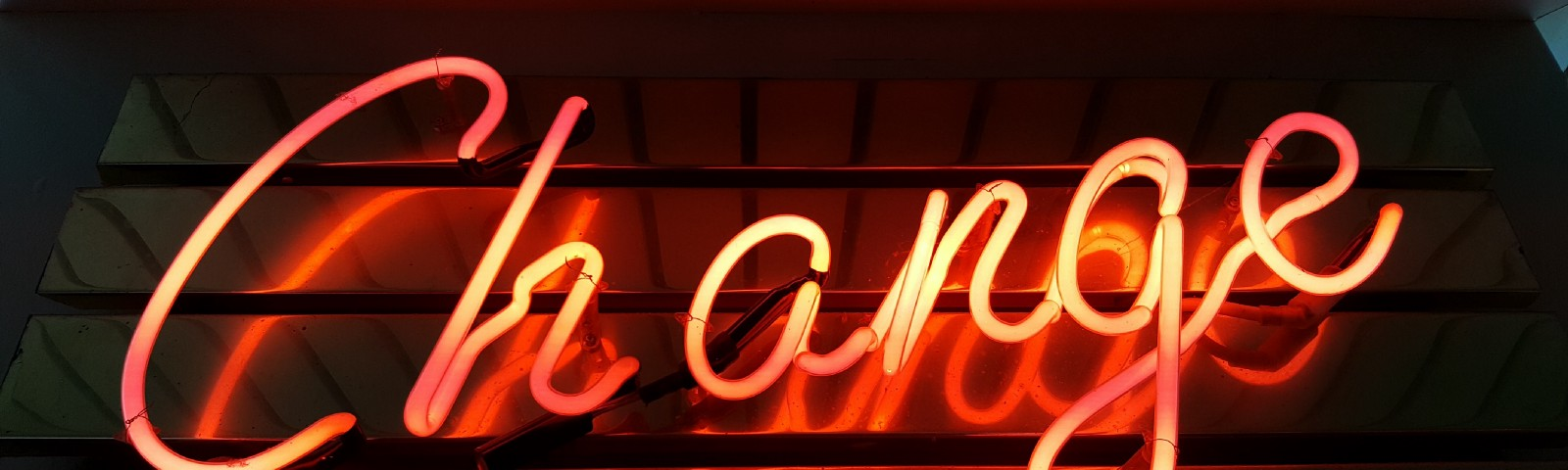 """Neon sign spelling out: """"Change"""""""