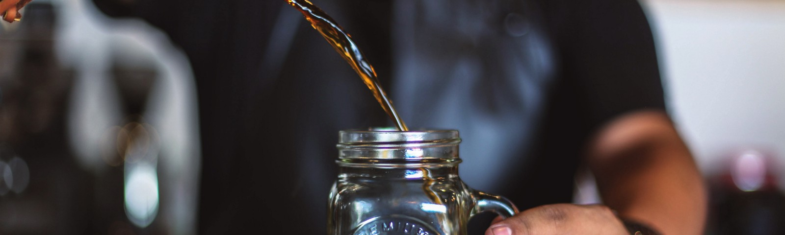 Pouring cold brew coffee into jar