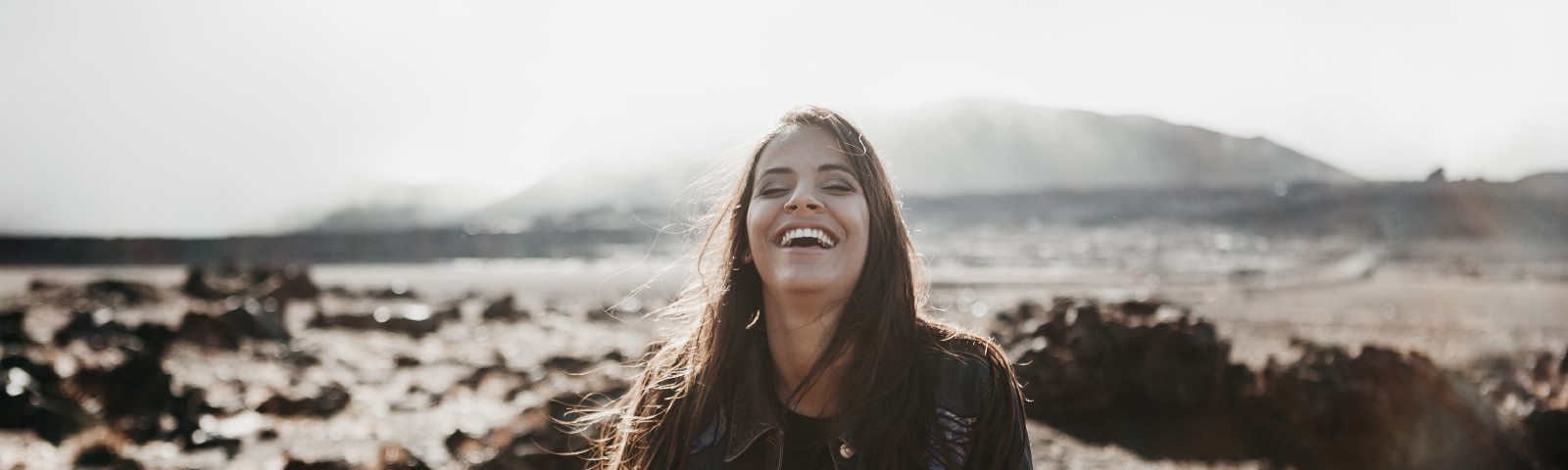 Young woman smiling in the desert.