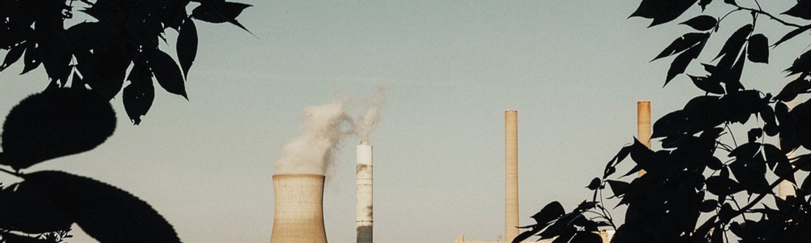 Photo of a power plant releasing fumes, CO2 into the at