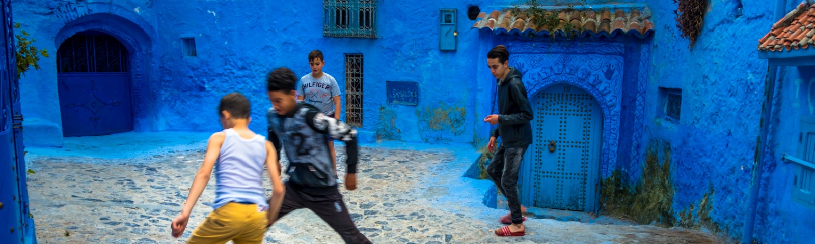 Soccer with 2 on each side in a tiny courtyard in Chefchaoeun, Morocco