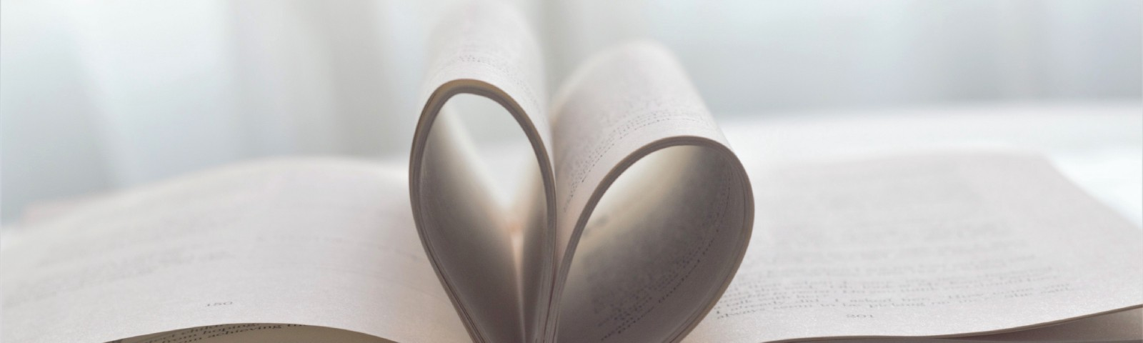Book pages folded into heart.