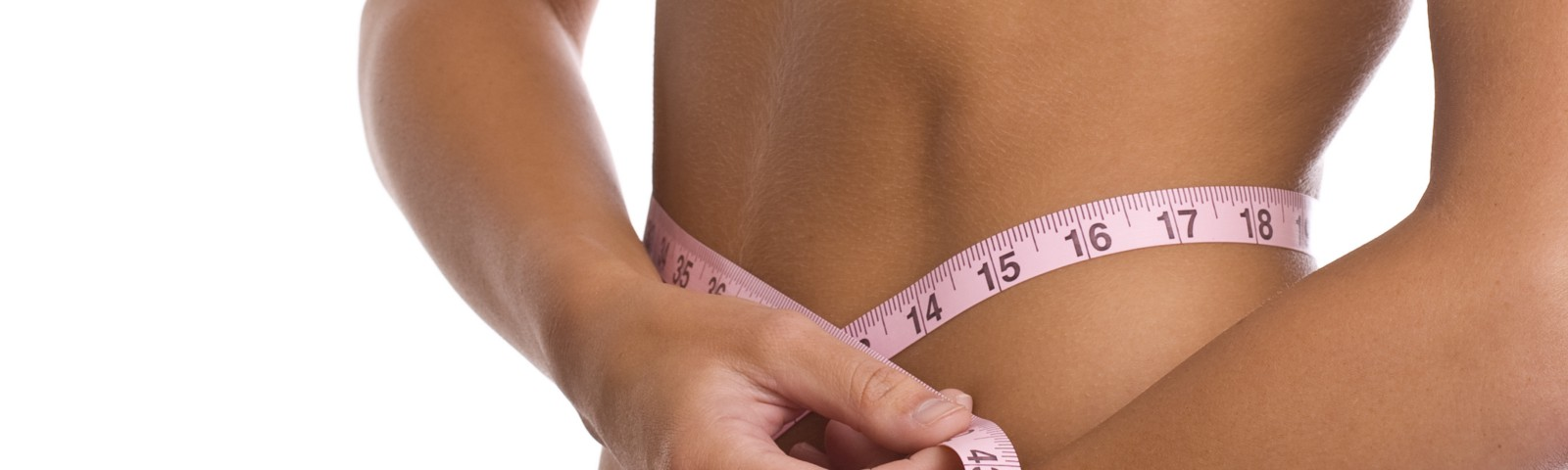 Woman measuring her waist trying to lose weight