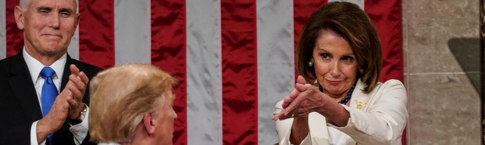 Donald Trump turns to House speaker Nancy Pelosi as he delivers his State of the Union address.