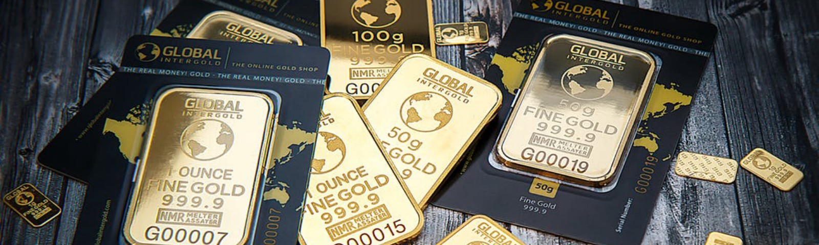 Many gold bars on a wooden table.