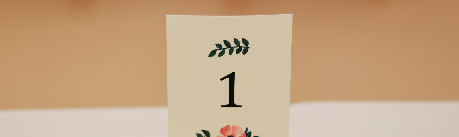 A flowered place setting in a wine cork, with the number 1 on it
