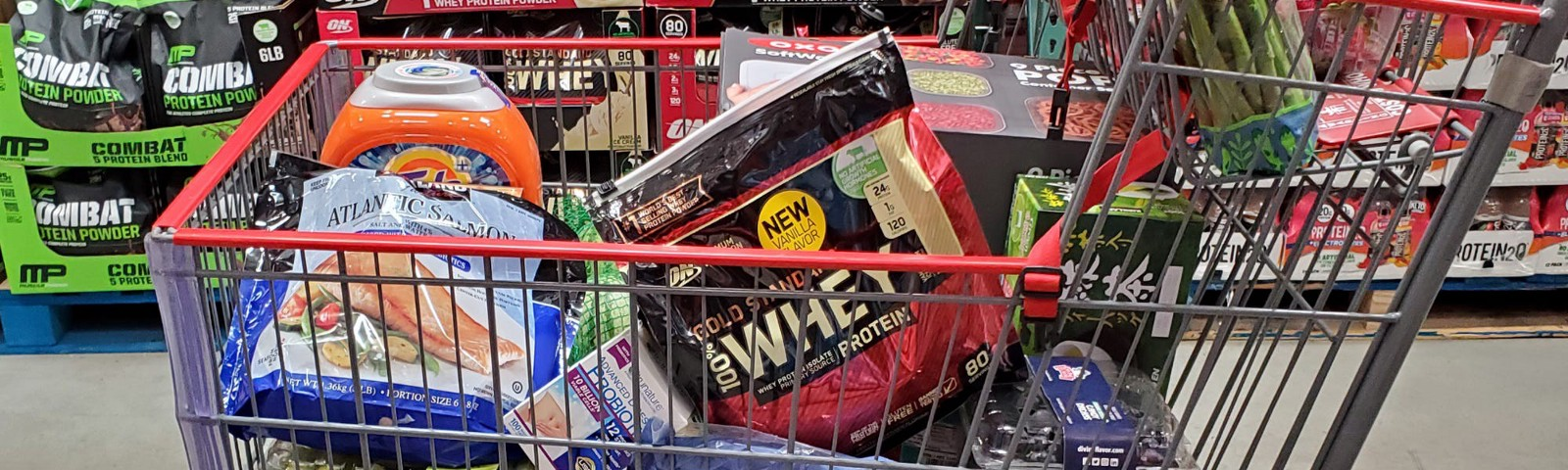 A Costco shopping cart filled with items.