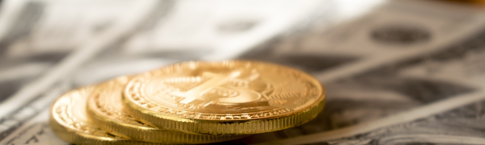 A picture of some dollar and coin