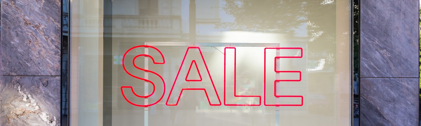 glass window with the word Sale in red letters
