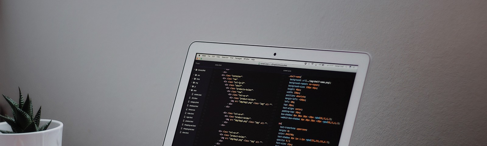 Image of laptop with code.