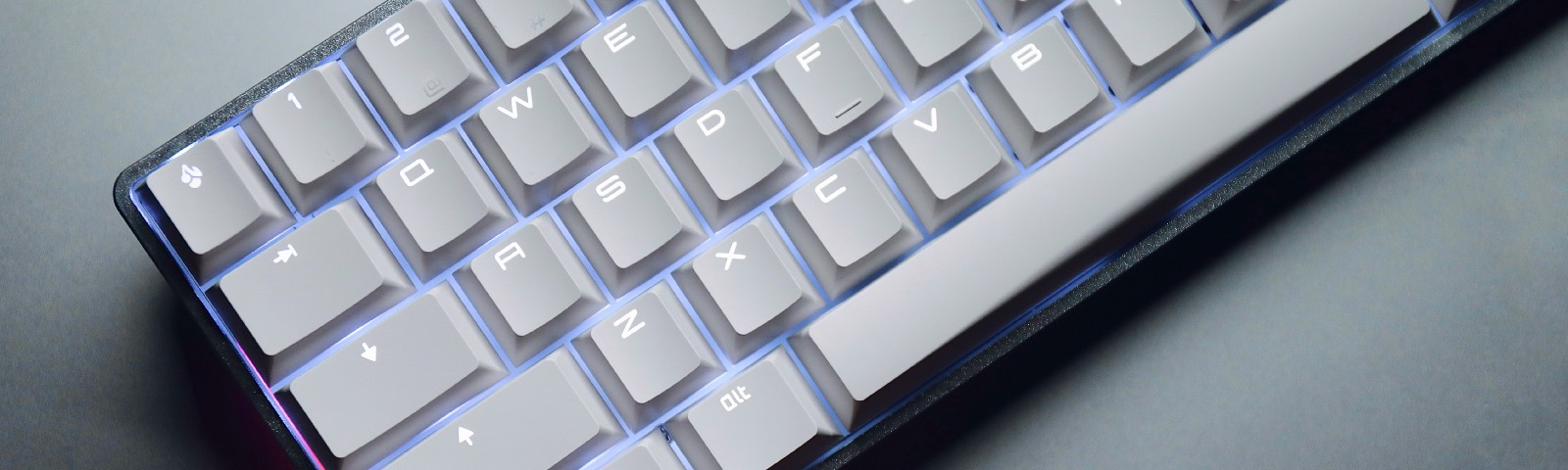 a white mechanical keyboard with white leds