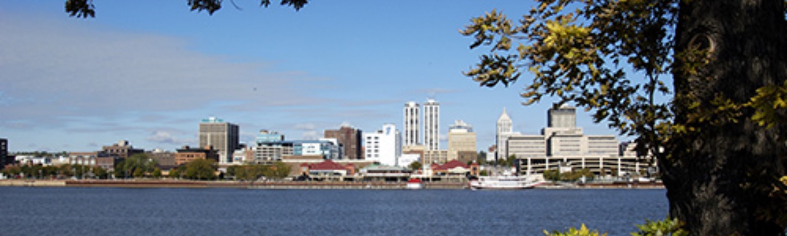 City of Peoria Illinois downtown skyline and trees on the The Illinois River
