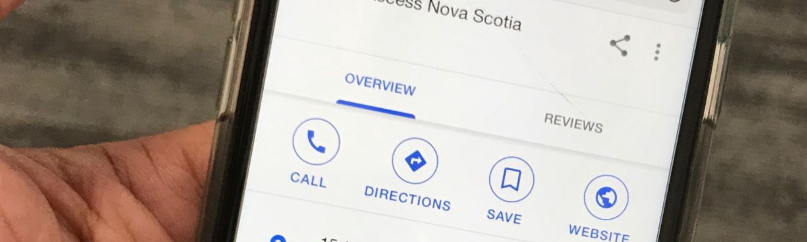 A cell phone showing Google location information for an Access Nova Scotia service location.