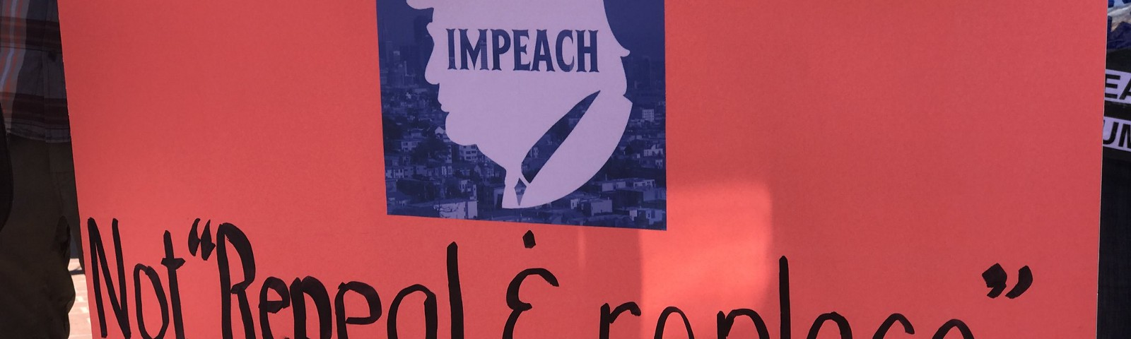 """Cardboard sign that has an silouette of Trump and the words: Not """"repeal & replace""""—Impeach and Convict!"""