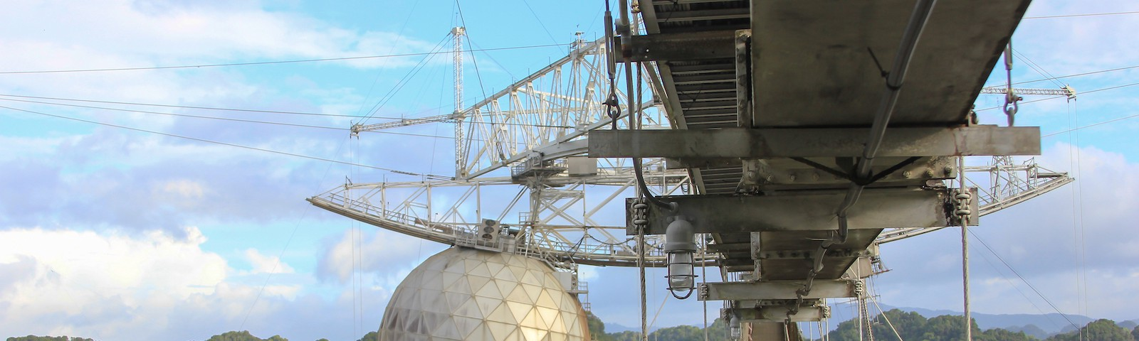 A walkway hanging above a deep valley which holds the telescope.
