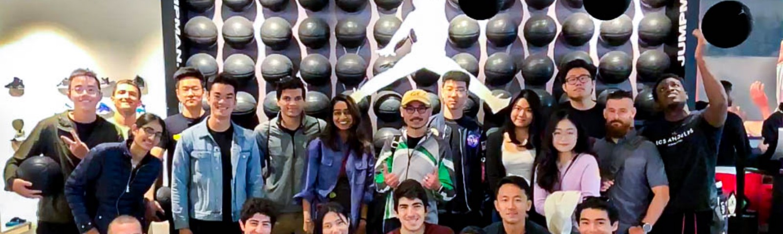 The Blue Goji teams posing in the Jordan Jumpman Store.