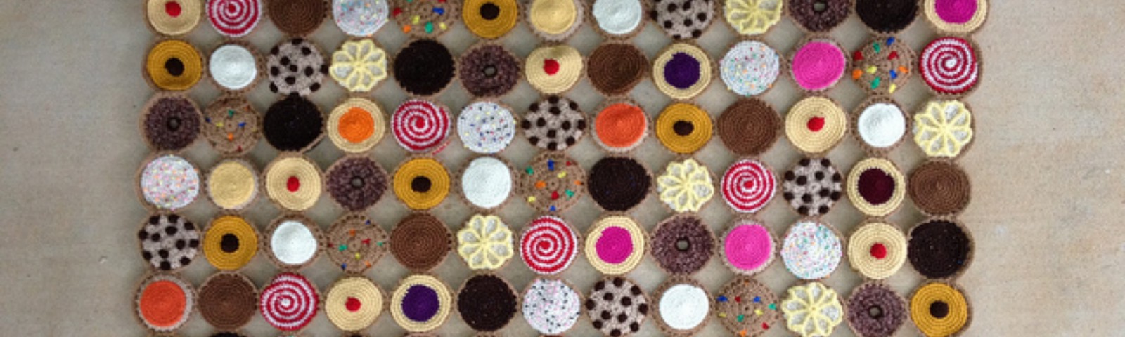 One-hundred and sixty-nine crochet cookies arranged and joined to form a square crochet blanket