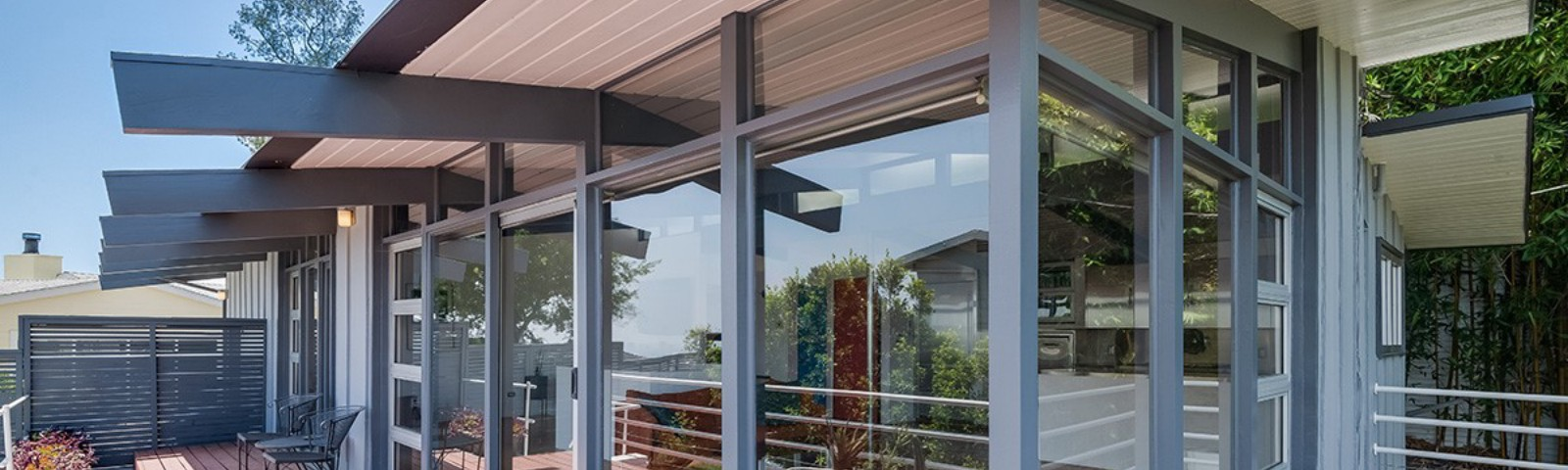 Floor to ceiling windows and pointed beams of a mid-century home in the San Fernando Valley.