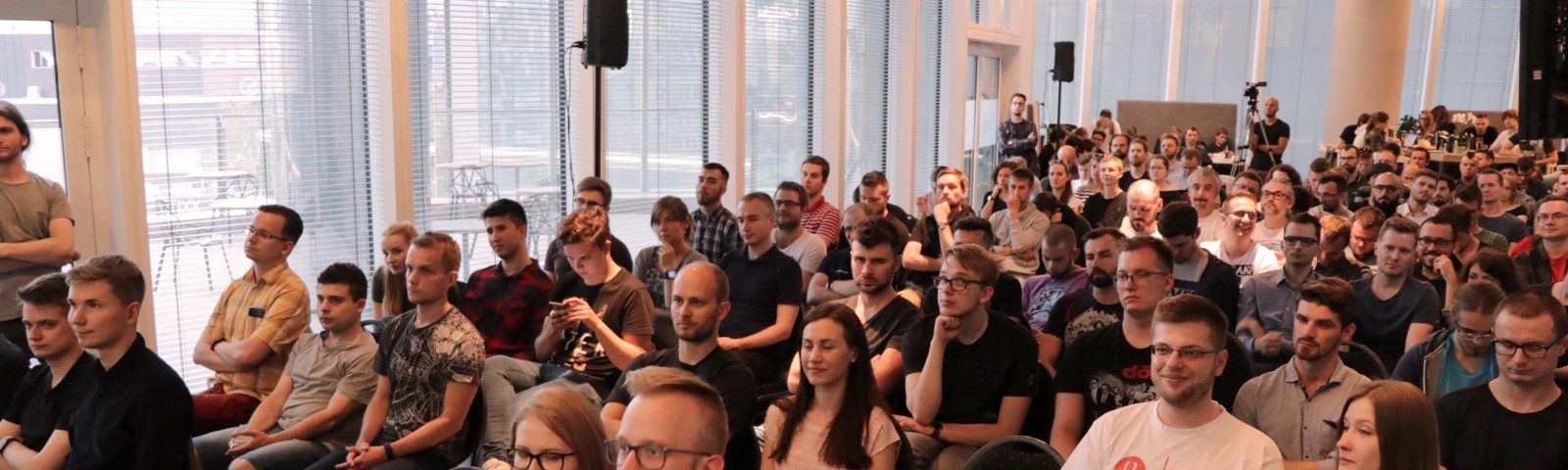 Photo from WarsawJS Meetup presents a crowded space at Warsaw Spire