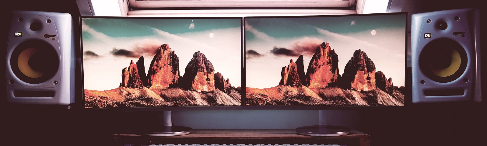A second screen next to a first. The background image is of mountains.