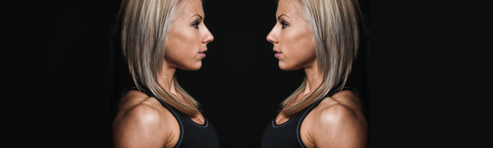 A woman looking at her mirror reflection for How Your Reflection Can Help You Eat Less, Lose Weight, & Tell the Truth