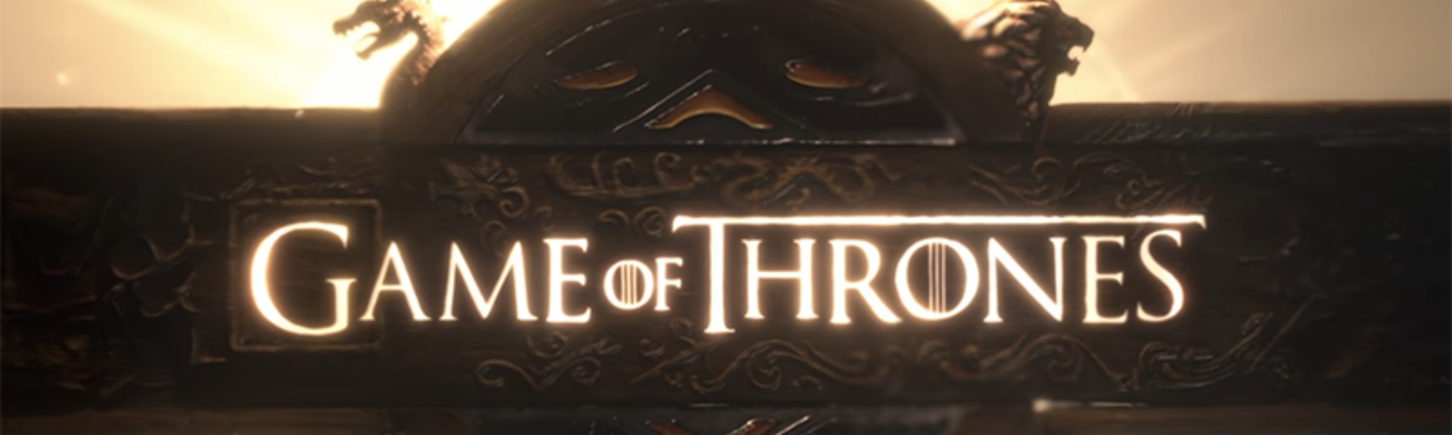 """A seal with the words """"Game of Thrones,"""" lit from behind and decorated with dragon, lion, dire wolf, and stag heads."""