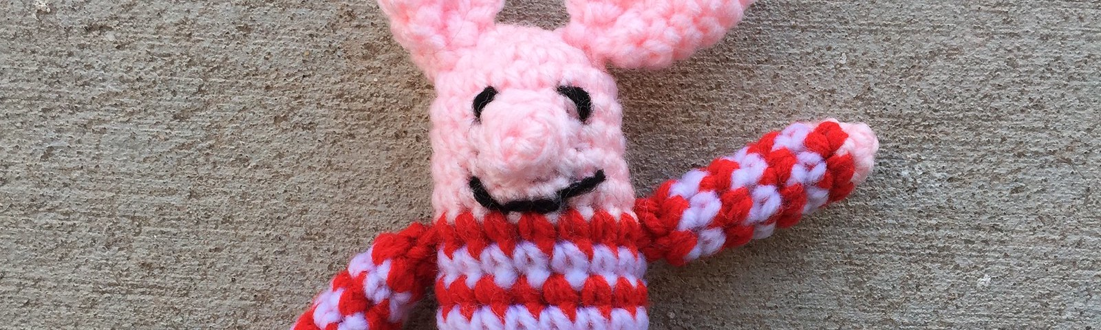A miniature meta crochet pig named Olivette