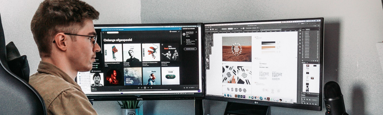A designer is working in front of the computer