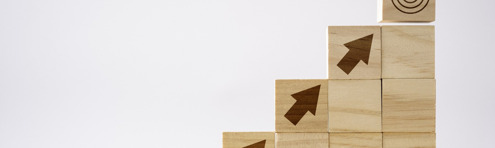 Set of wooden blocks showing arrow pointing to target