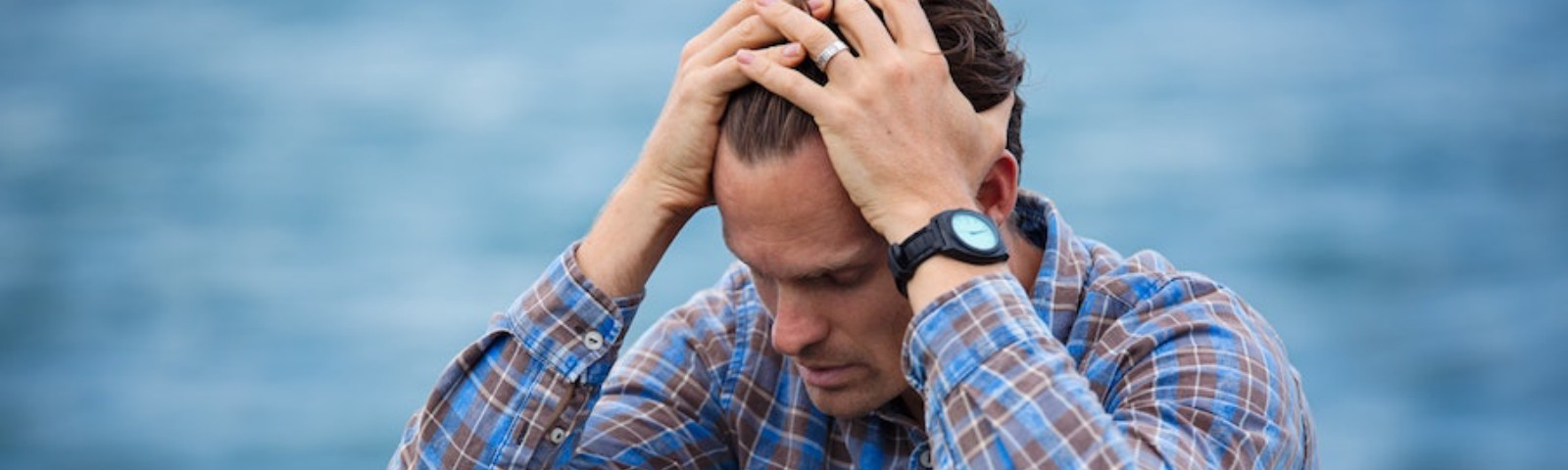 Frustrated man with his hands on his head