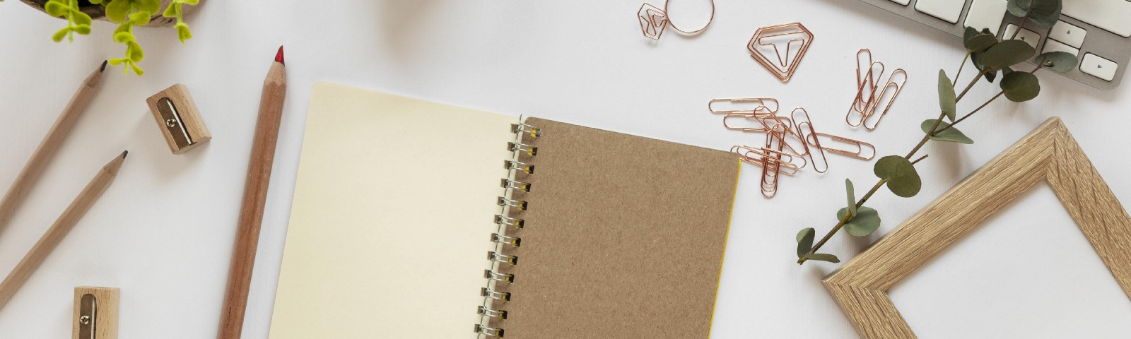 A diary and pencil on work desk