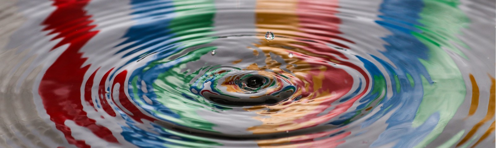 A drop of surface water with colours reflecting — Design A Digital Product For Sustainability by Paul Myers