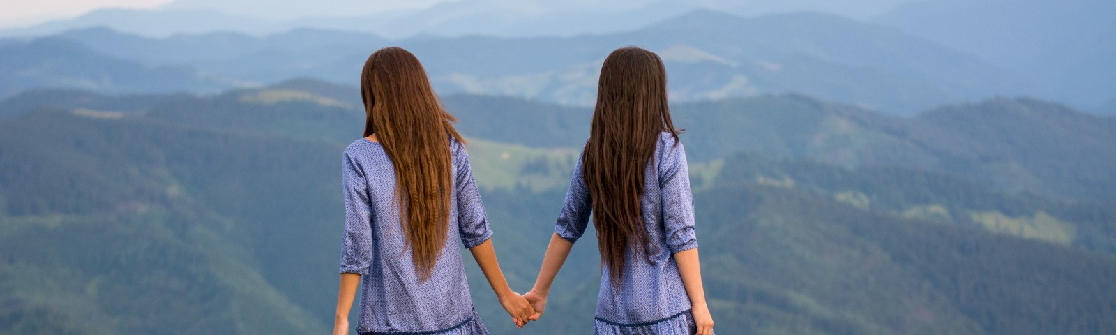 Two women looking over the mountains