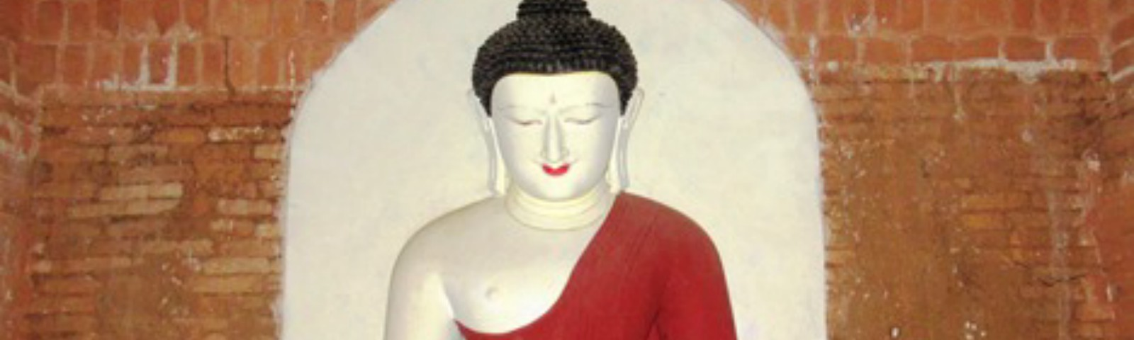 a seated Buddha with red robes