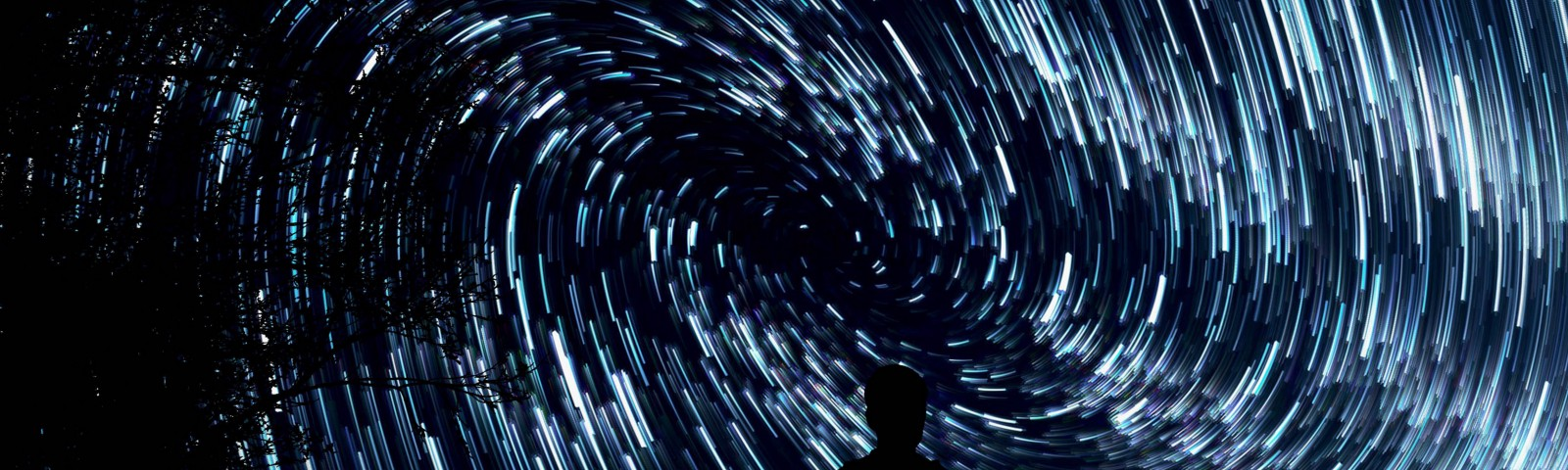 Man staring up at a night sky filled with swirling stars