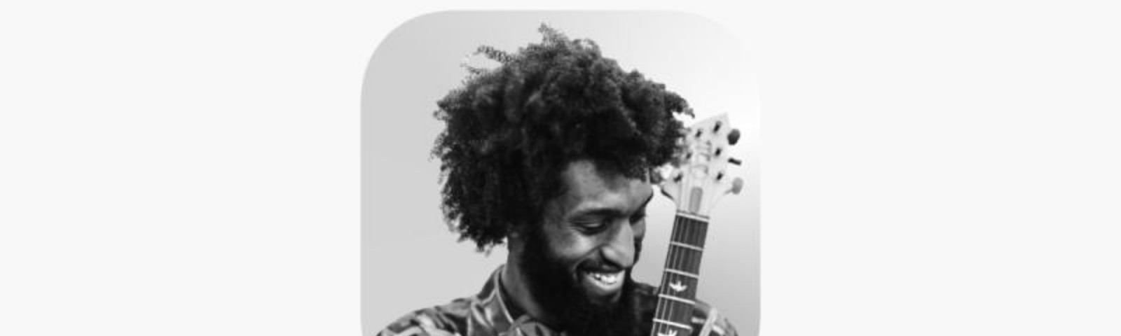 the Clubhouse app icon is a picture of a Black man with a beard and curly hair. He's smiling and holding a guitar.