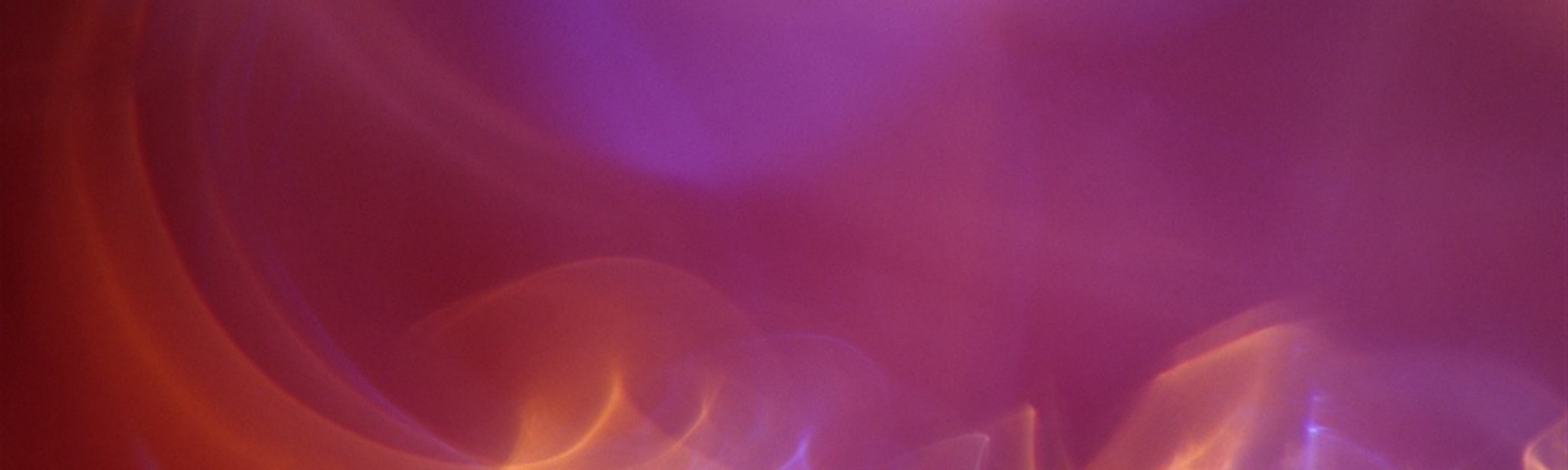 Pink abstract photograph with swirls of light, created for healing by medical doctor