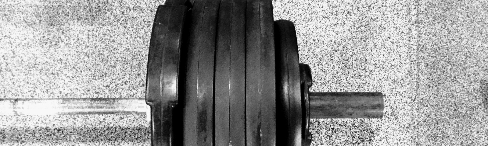 A barbell with plates on the floor