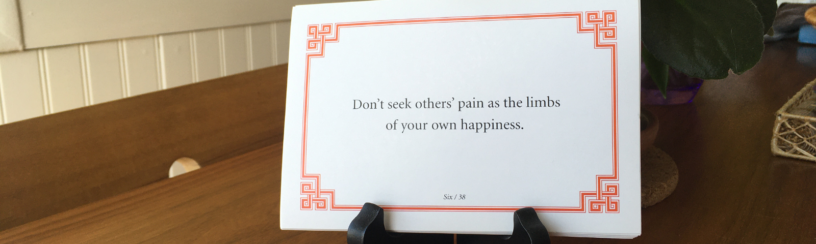 """Lojong slogan card reading """"Don't seek others' pain as the limbs of your own happiness."""""""
